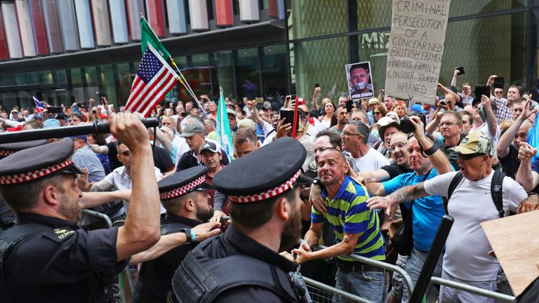 Supporters of Tommy Robinson clash with police outside the Old Bailey in London after the former EDL leader was found in contempt of court by High Court judges for filming defendants in a criminal trial and broadcasting the footage on social media. PRESS ASSOCIATION Photo. Picture date: Friday July 5, 2019. See PA story COURTS Robinson. Photo credit should read: Aaron Chown/PA Wire
