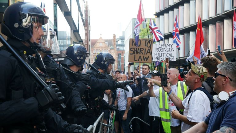 People protest outside the Old Bailey after British far-right activist and former leader and founder of English Defence League (EDL), Tommy Robinson