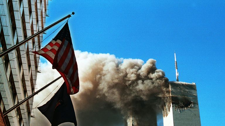 Smoke pours from the World Trade Center after being hit by two planes September 11, 2001