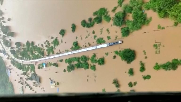 Around 700 people were rescued from a train stranded in monsoon waters on the outskirts of India's financial capital Mumbai