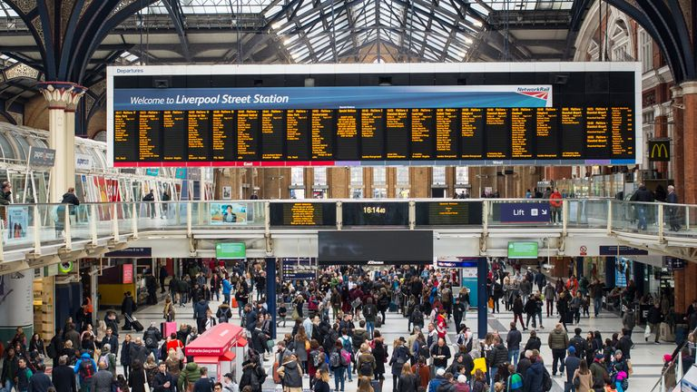 Liverpool Street Station, London, England, UK - April 2019: People tourists and commuters in the hall of the busy London Liverpool Street Station (Liverpool Street Station, London, England, UK - April 2019: People tourists and commuters in the hall of