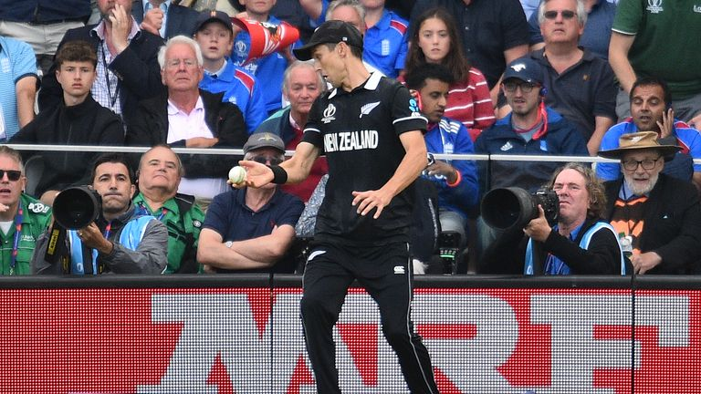 Realising he has stepped on the boundary, Trent Boult flicks the ball away