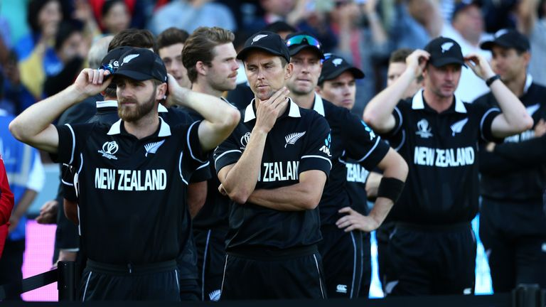 New Zealand's Kane Williamson (L) and Trent Boult (3L) try to take in their defeat
