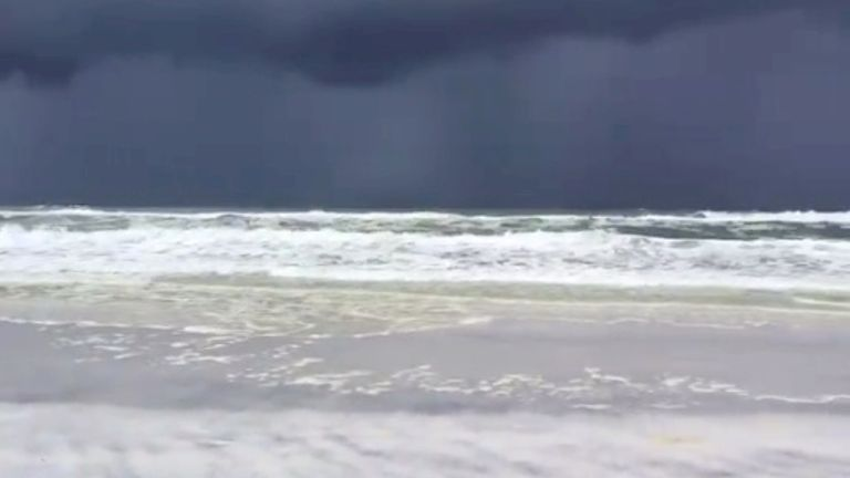 Storm clouds approach Santa Rosa Beach in Seaside, Florida, on Friday