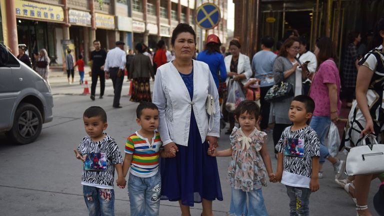 A Uighur woman and her children in Kashgar, Xinjiang