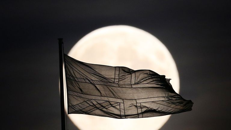 LONDON, ENGLAND - SEPTEMBER 08: A Union flag flutters in sight of the near full moon in Whitehall on September 8, 2014 in London, England. A supermoon or harvest moon involves a full moon coinciding with it's closest approach to the Earth on it's elliptical orbit. This is the third sighting of a supermoon this year with it occuring in full tonight. (Photo by Peter Macdiarmid/Getty Images)