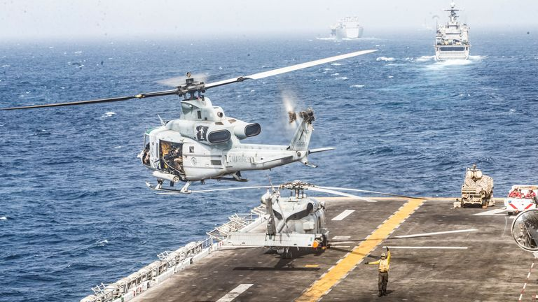 A UH-1Y Venom helicopter with Marine Medium Tiltrotor Squadron (VMM) 163 (Reinforced), 11th Marine Expeditionary Unit (MEU), takes off from the flight deck of the amphibious assault ship USS Boxer (LHD 4) during its transit through Strait of Hormuz in Gulf of Oman, Arabian Sea