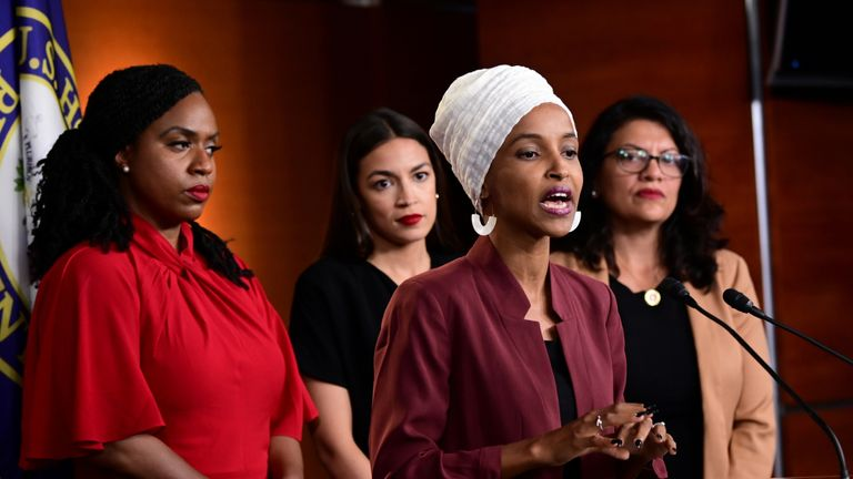 Ilhan Omar speaks as Ayanna Pressley, Rashida Tlaib and Alexandria Ocasio-Cortez look on