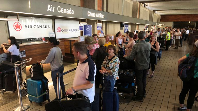 Passengers from an Australia-bound Air Canada flight diverted to Honolulu after about 35 people were injured during turbulence