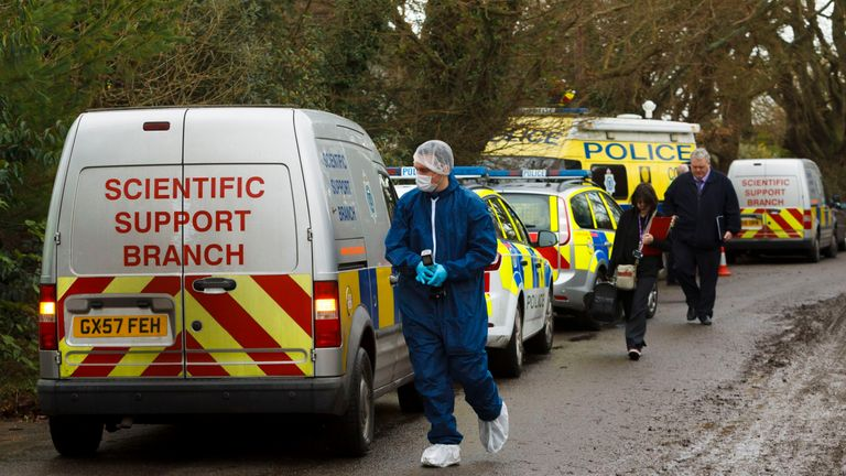Police forensics officers arriving at the house where Valerie Graves was found dead