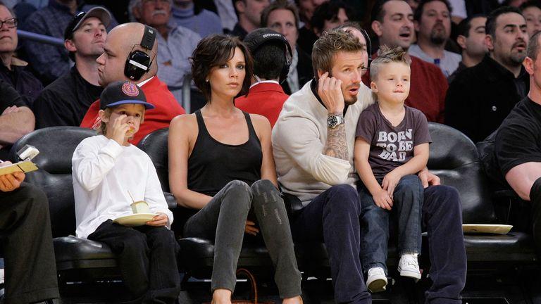 Cruz Beckham, Victoria Beckham, David Beckham and Romeo Beckham attend the Los Angeles Lakers vs Dallas Mavericks game on October 30, 2009 in Los Angeles, California