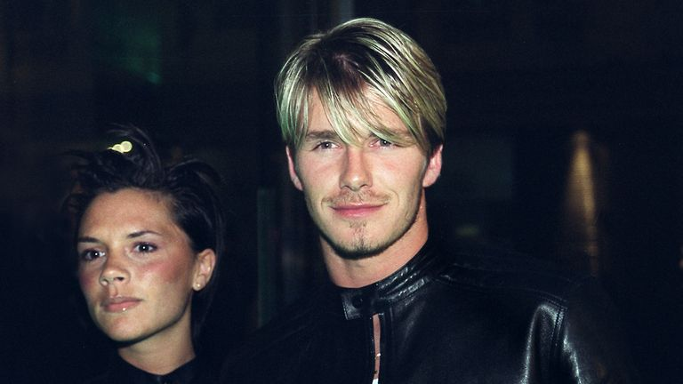 "Spice Girl Victoria Adams (L) arrives with husband, Manchester United and England star David Beckham (R), to a Versace star-studded reception hosted by Donatella Versace in London late Friday 11 June 1999. The reception comes after the Versace ""Diamonds are forever"" charity fashion event 09 June which raised funds for three charities including the Prince's Foundation for architecture and the environment. (Photo credit should read SINEAD LYNCH/AFP/Getty Images)"