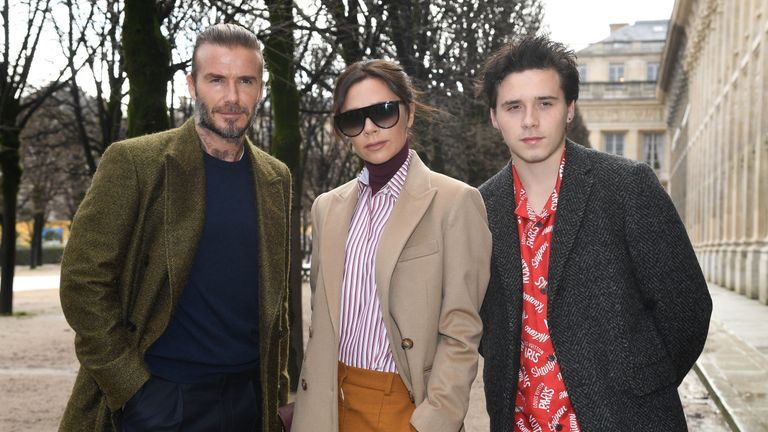 David, Victoria and Brooklyn Beckham attend the Louis Vuitton Menswear Fall/Winter 2018-2019 show as part of Paris Fashion Week on January 18, 2018 in Paris, France
