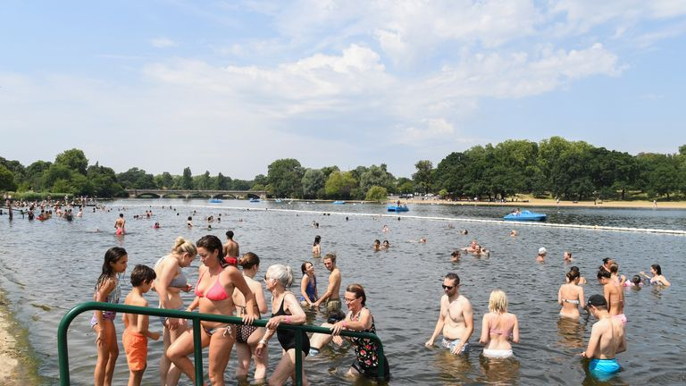 LONDON, ENGLAND - JULY 25: People attempt to cool off from the high temperatures in Hyde Park's Serpentine lake on July 25, 2019 in London, United Kingdom. The Met Office issued a weather warning from 3pm this afternoon. They warn that Britain could face up to 13 hours of electrical storms after it was forecast that temperatures could reach a record-breaking 39C. (Photo by James D. Morgan/Getty Images)