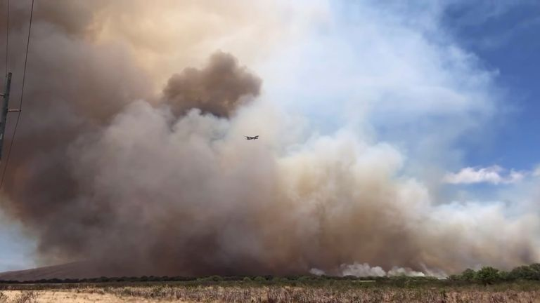 A plane flies through the smoke. Pic: John Sandbach Photography