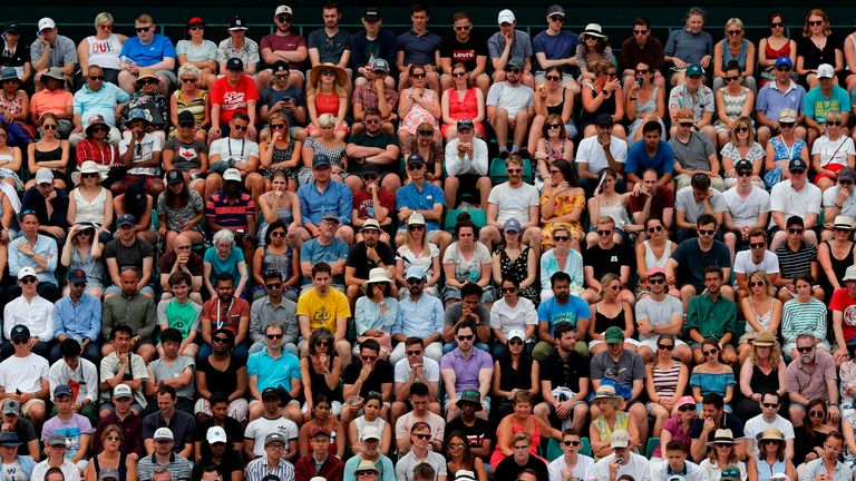 Spectators watch Britain's Jamie Murray and Britain's Neal Skupski playing Croatia's Ivan Dodig and Slovakia's Filip Polasek during their men's doubles first round match on the fifth day of the 2019 Wimbledon Championships at The All England Lawn Tennis Club in Wimbledon, southwest London, on July 5, 2019