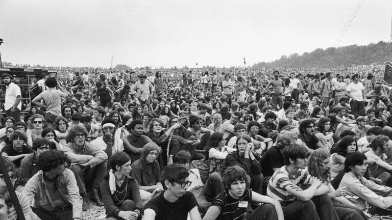 Crowd gather at the original 1969 Woodstock Festival in New York