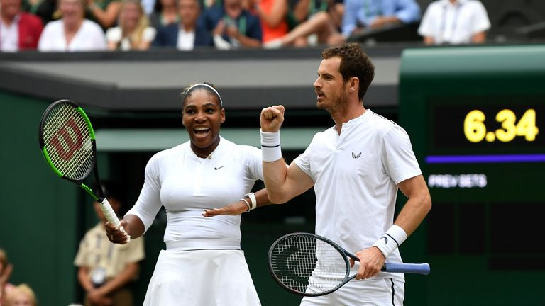 Andy Murray (R) and US player Serena Williams (L) celebrate winning a point against France's Fabrice Martin and US player Raquel Atawo during their mixed doubles second round match on day eight of the 2019 Wimbledon Championships at The All England Lawn Tennis Club in Wimbledon, southwest London, on July 9, 2019.