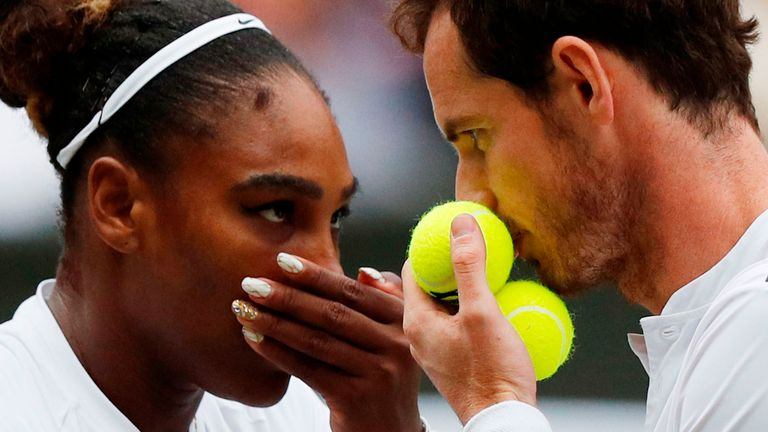 Andy Murray (R) and US player Serena Williams (L) speak between points against France's Fabrice Martin and US player Raquel Atawo during their mixed doubles second round match on day eight of the 2019 Wimbledon Championships at The All England Lawn Tennis Club in Wimbledon, southwest London, on July 9, 2019.