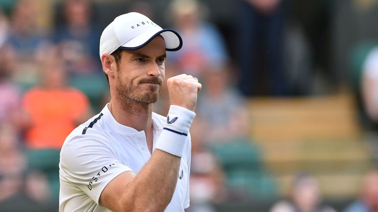 Andy Murray celebrates after winning a point against Romania's Marius Copil and France's Ugo Humbert during their men's doubles second round match on the fourth day of the 2019 Wimbledon Championships at The All England Lawn Tennis Club in Wimbledon, southwest London, on July 4, 2019.