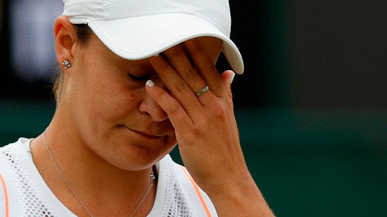 Australia's Ashleigh Barty reacts after losing a point against US player Alison Riske during their women's singles fourth round match on the seventh day of the 2019 Wimbledon Championships at The All England Lawn Tennis Club in Wimbledon, southwest London, on July 8, 2019.