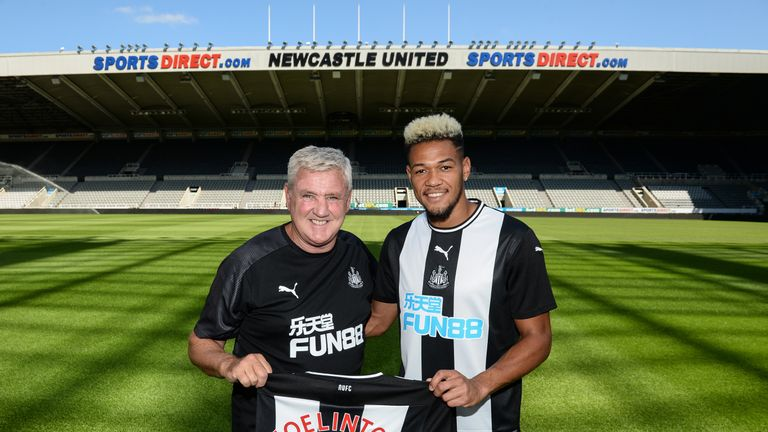 NEWCASTLE UPON TYNE, ENGLAND - JULY 23: New signing Joelinton poses for a photograph pitch side with Head Coach Steve Bruce during a photoshoot at St.James' Park on July 23, 2019 in Newcastle upon Tyne, England.Photo by Serena Taylor/Newcastle United via Getty Images) *** Local Caption ***Joelinton;Steve Bruce