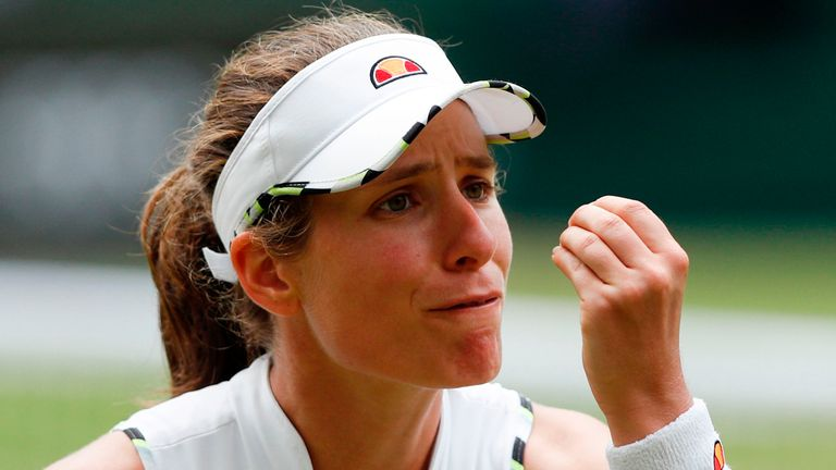 Johanna Konta reacts after hitting a shot out against Czech Republic's Barbora Strycova during their women's singles quarter-final match on day eight of the 2019 Wimbledon Championships at The All England Lawn Tennis Club in Wimbledon, southwest London, on July 9, 2019.