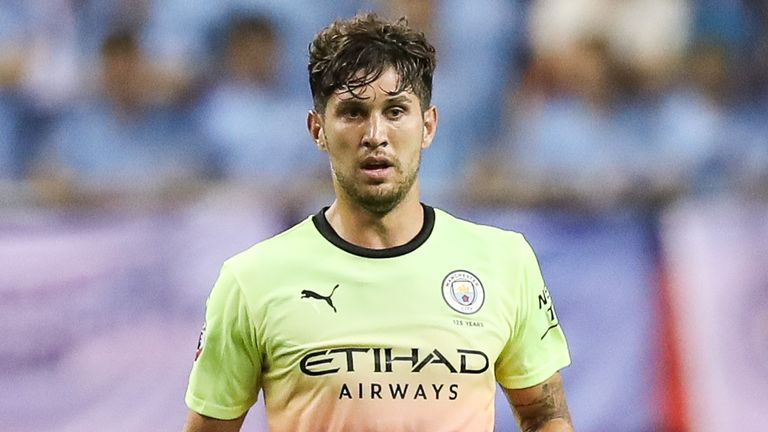 John Stones has been backed by manager Pep Guardiola to improve at Manchester City