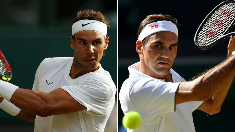 Spain's Rafael Nadal (L) and Switzerland's Roger Federer returning the ball during the 2019 Wimbledon Championships at The All England Lawn Tennis Club in Wimbledon, on July 4, 2019
