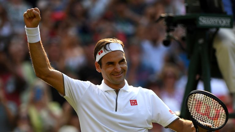 Roger Federer of Switzerland celebrates victory in his Men's Singles Quarter Final match against Kei Nishikori of Japan during Day Nine of The Championships - Wimbledon 2019 at All England Lawn Tennis and Croquet Club on July 10, 2019 in London, England