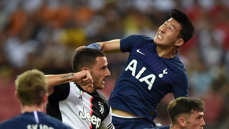 Tottenham Hotspur's Son Heung-Min (top R) jumps to head the ball past Juventus' Leonardo Bonucci (L) during the International Champions Cup football match between Juventus and Tottenham Hotspur in Singapore on July 21, 2019. (Photo by Roslan RAHMAN / AFP) (Photo credit should read ROSLAN RAHMAN/AFP/Getty Images)