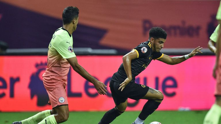 Wolverhampton Wanderers' Morgan Gibbs-White (R) runs with the ball against Manchester City during their final match of the 2019 Premier League Asia Trophy football tournament at the Hongkou Stadium in Shanghai on July 20, 2019. (Photo by HECTOR RETAMAL / AFP) (Photo credit should read HECTOR RETAMAL/AFP/Getty Images)