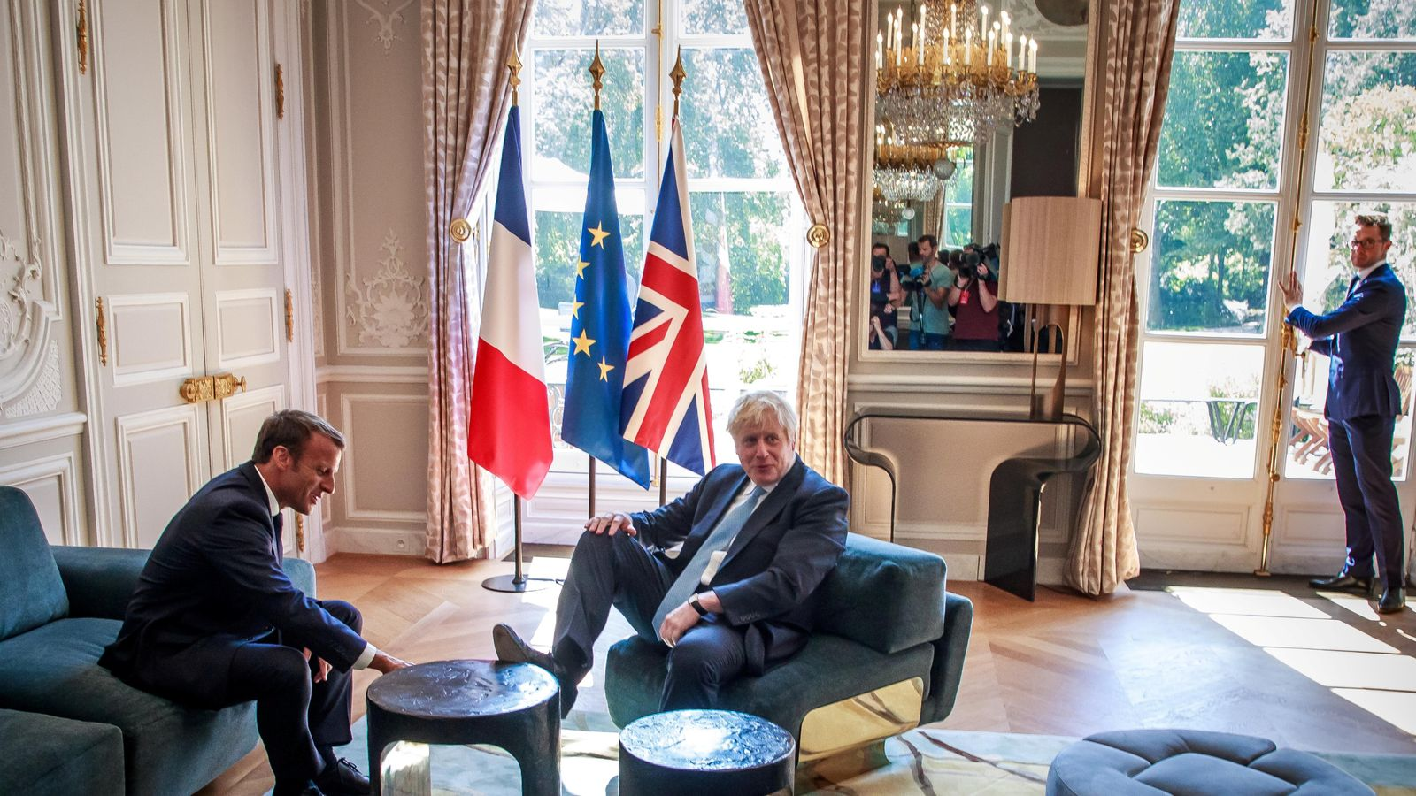 What's behind PM's foot on table at Macron's palace?