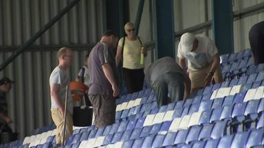 Bury fans help clean Gigg Lane