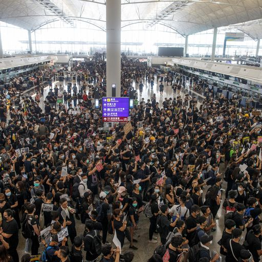 Hong Kong airport cancels all remaining flights as democracy protesters flood terminal