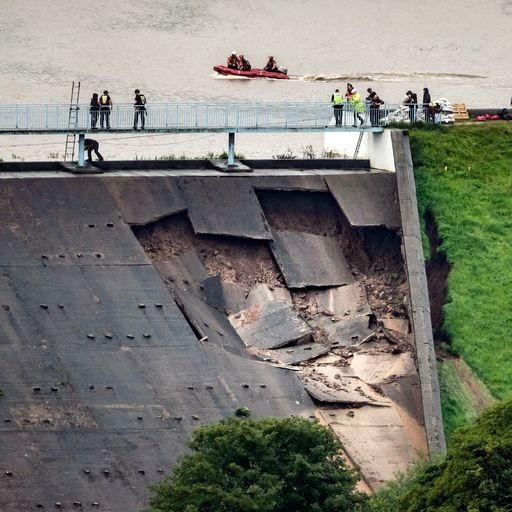 Stay away: Town evacuated after dam wall collapses in heavy rain