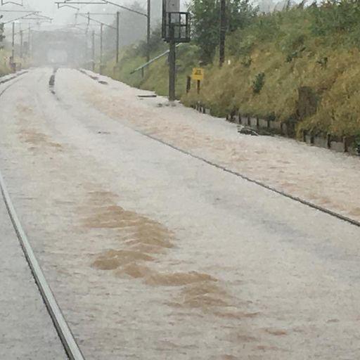 Floods shut West Coast Main Line between Scotland and England