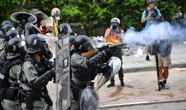 Hong Kong police fire tear gas in new protests over surveillance fears