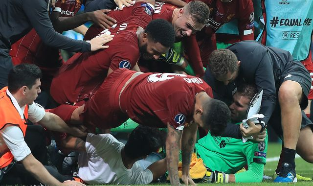 Liverpool's Adrian injured by celebrating fan at Super Cup