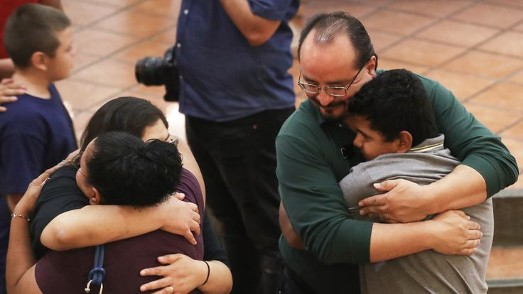 People hug at St Pius X Church at a vigil for victims after a mass shooting which left at least 20 people dead on August 3, 2019 in El Paso, Texas. A 21-year-old white male suspect was taken into custody in the city which sits along the U.S.-Mexico border. At least 26 people were wounded. (Photo by Mario Tama/Getty Images)