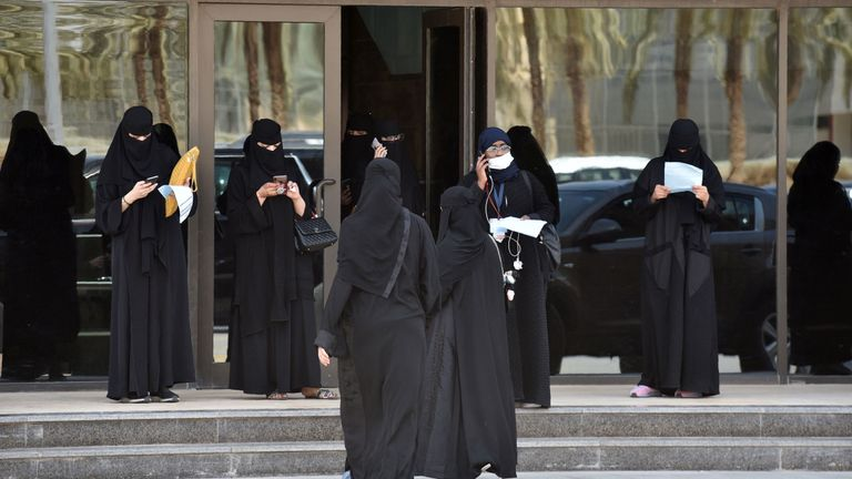 Saudi female driving trainees gather at the entrance of the Saudi Driving School (SDS) in the capital Riyadh on June 24, 2019. - Until June 24 last year, driving for women would have been considered a crime in Saudi Arabia, where hardliners have preached for decades that allowing the act would promote gender mixing and promiscuity. (Photo by FAYEZ NURELDINE / AFP)        (Photo credit should read FAYEZ NURELDINE/AFP/Getty Images)