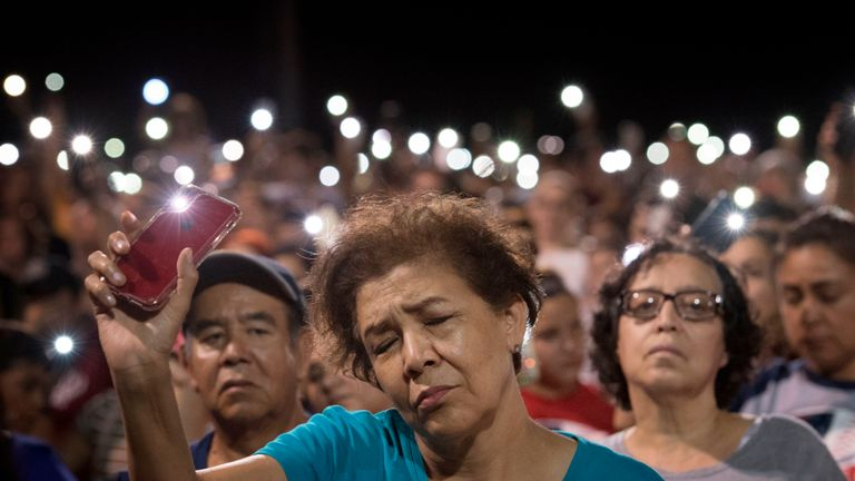 People react during a prayer vigil organized by the city, after a shooting left 20 people dead at the Cielo Vista Mall Wal-Mart in El Paso, Texas, on August 4, 2019. - The United States mourned Sunday for victims of two mass shootings that killed 29 people in less than 24 hours as debate raged over whether President Donald Trump's rhetoric was partly to blame for surging gun violence. The rampages turned innocent snippets of everyday life into nightmares of bloodshed: 20 people were shot dead while shopping at a crowded Walmart in El Paso, Texas on Saturday morning, and nine more outside a bar in a popular nightlife district in Dayton, Ohio just 13 hours later. (Photo by Mark RALSTON / AFP) (Photo credit should read MARK RALSTON/AFP/Getty Images)