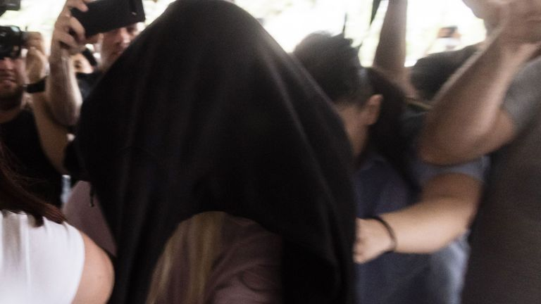 This picture taken on July 29, 2019 shows a British teenager who accused seven Israelis of gang rape arriving at the Famagusta District Court in Paralimni in eastern Cyprus, to face charges of making a false allegation. - Initially, the 19-year-old woman had alleged that 12 Israelis gang raped her at the hotel where she was staying in the popular Ayia Napa resort on July 17. The young Israeli tourists were remanded in custody the next day. But hours before their second appearance in court five of them were released and sent home late the next day. (Photo by Iakovos Hatzistavrou / AFP)        (Photo credit should read IAKOVOS HATZISTAVROU/AFP/Getty Images)