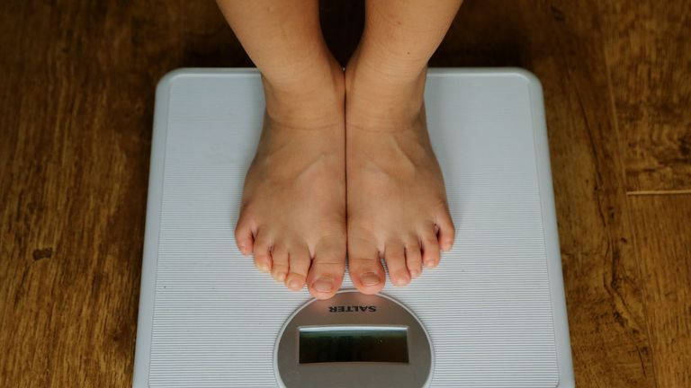 EMBARGOED TO 1600 WEDNESDAY JULY 24 File photo dated 15/07/14 of a person being weighed on scales. Women who are considered to be normal weight as measured by body mass index (BMI) could actually be at high risk for death because of their waist size, a new study suggests.