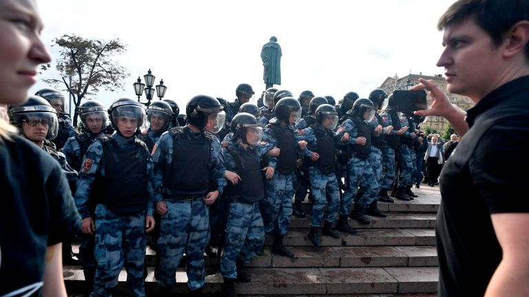 Servicemen of the Russian National Guard block an area during an unsanctioned rally urging fair elections at Moscow's Pushkinskaya Square on August 3, 2019. - The rally is the latest in a series of demonstrations after officials refused to let popular opposition candidates run in next month's city parliament elections. (Photo by Alexander NEMENOV / AFP)        (Photo credit should read ALEXANDER NEMENOV/AFP/Getty Images)