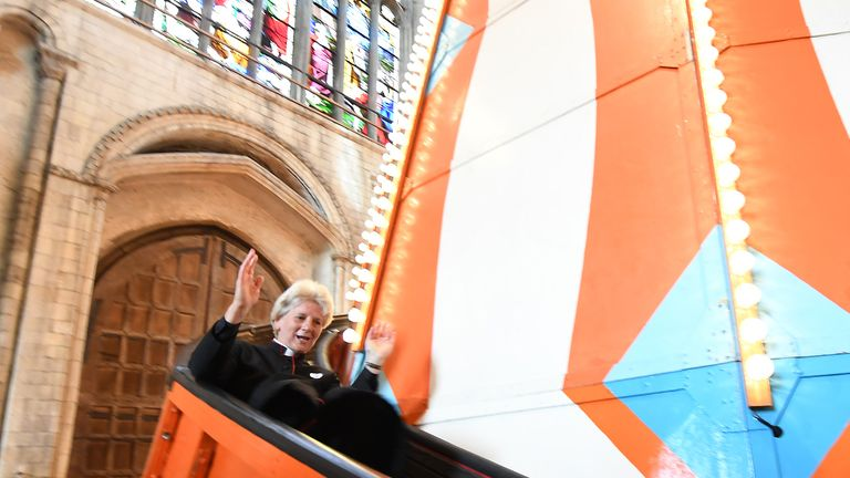Dean of Norwich, The Very Reverend Jane Hedges goes down a 40ft helter skelter installed inside Norwich Cathedral as part of the Seeing It Differently project which aims to give people the chance to experience the Cathedral in an entirely new way and open up conversations about faith.