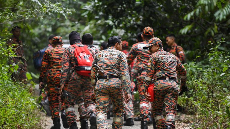 Members of Malaysian rescue team take part in a search and rescue operation for the missing 15-year-old Franco-Irish, Nora Quoirin in Seremban on August 7, 2019. - A helicopter and dozens of people were deployed August 7 on the third day of a search for a vulnerable London teenager who went missing from a Malaysian rainforest resort, police said. (Photo by Mohd RASFAN / AFP) (Photo credit should read MOHD RASFAN/AFP/Getty Images)