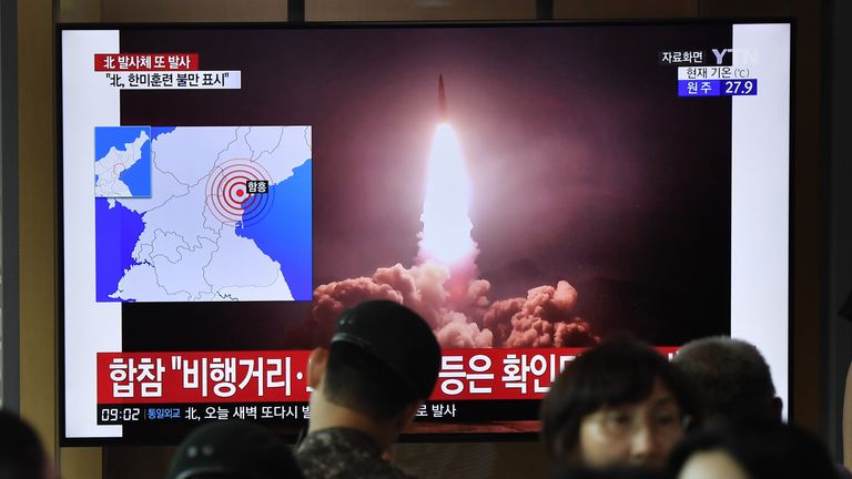 "People watch a television news screen showing file footage of North Korea's missile launch, at a railway station in Seoul on August 10, 2019. - North Korea fired two ""unidentified projectiles"" on August 10, into the sea, South Korea's Yonhap news agency reported, citing the country's Joint Chiefs of Staff -- the latest in a series of such launches by Pyongyang. (Photo by Jung Yeon-je / AFP)        (Photo credit should read JUNG YEON-JE/AFP/Getty Images)"