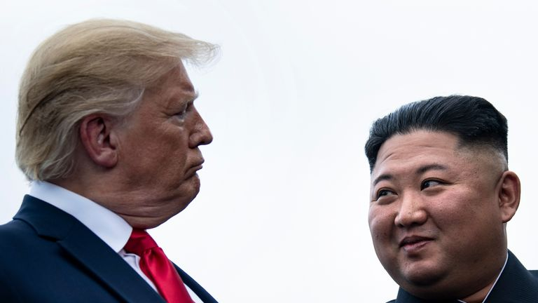 TOPSHOT - US President Donald Trump and North Korea's leader Kim Jong-un talk before a meeting in the Demilitarized Zone(DMZ) on June 30, 2019, in Panmunjom, Korea. (Photo by Brendan Smialowski / AFP)        (Photo credit should read BRENDAN SMIALOWSKI/AFP/Getty Images)
