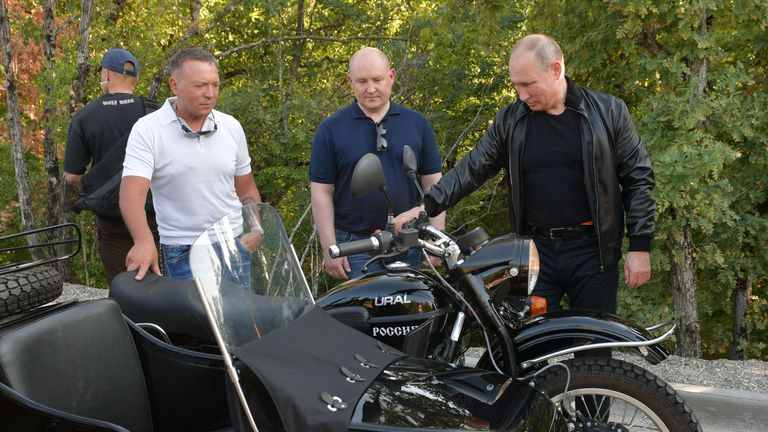 "Russia's President Vladimir Putin stands next to an Ural motorcycle during a bike show organized by motorcycling club ""Night Wolves"" in Sevastopol, Crimea August 10, 2019. Sputnik/Alexei Druzhinin/Kremlin via REUTERS  ATTENTION EDITORS - THIS IMAGE WAS PROVIDED BY A THIRD PARTY."